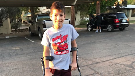 boy with crutches